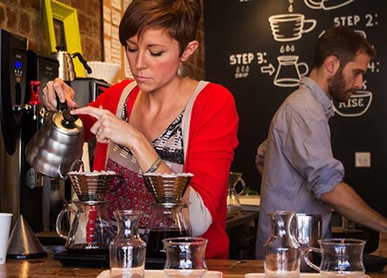 Co-owner Jessie Mueller prepares coffee with a kalita wave dripper. - MABEL SUEN
