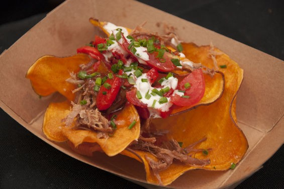 """Buttonwood Farm Turkey leg nachos with """"hoop house"""" grape tomatoes, roasted red pepper, house firecracker sauce, house buttermilk dressing, garden chives and sweet potato chips from Grapeseed. 