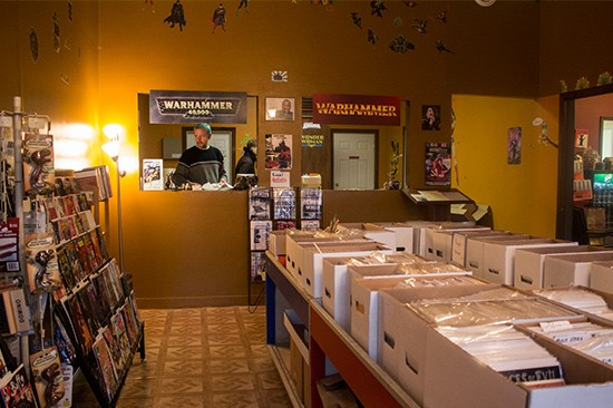 Co-owner Mike Dudley at the connected AM Trading Co. comic shop.