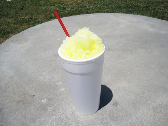 A pineapple snow cone. Please notice the utensil. - DR. FREEZE