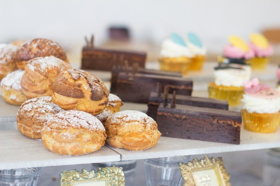 """The """"Choux du jour"""" alongside assorted desserts."""