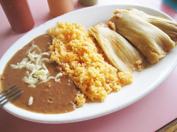 Tamales, with rice and refried beans, at Taqueria la Pasadita - IAN FROEB