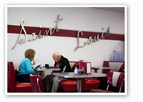 A couple sitting down for breakfast. | Mabel Suen