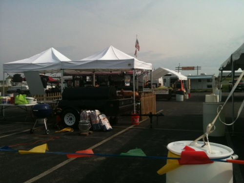 Barbecue competitors set up for Eckert's DadFest. - ROBIN WHEELER