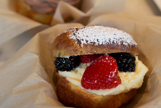 A cream puff filled with Piccione cream filling and topped with glazed berries. - MABEL SUEN