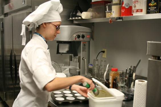 Stephanie Fischer preparing her signature pastries at Comet Coffee. | Chrissy Wilmes