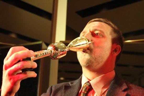 Kerne tastes victory from his trophy. | Evan C. Jones