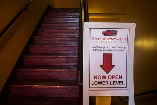 Signage pointing down the stairs.