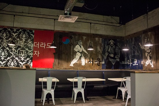 Murals of luchadors in marital arts gear illustrate the fusion concept.