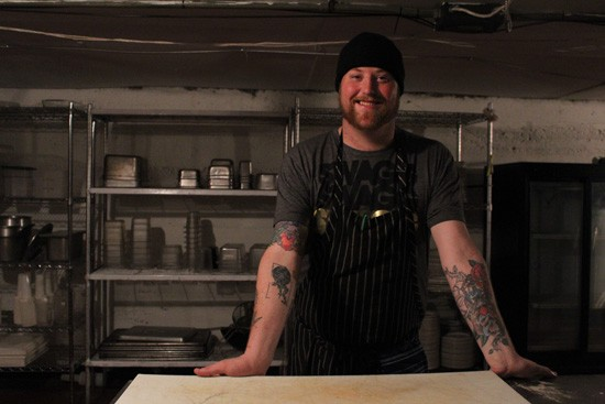 "Chef Jimmy Hippchen in The Crow's Nest's ""prep dungeon."" - MABEL SUEN"