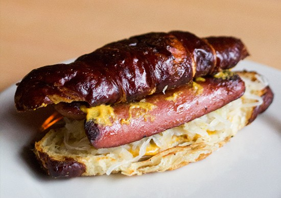 "The ""Alsatian Dawg,"" a Nathan's hot dog on a pretzel croissant with sauerkraut and spicy mustard."