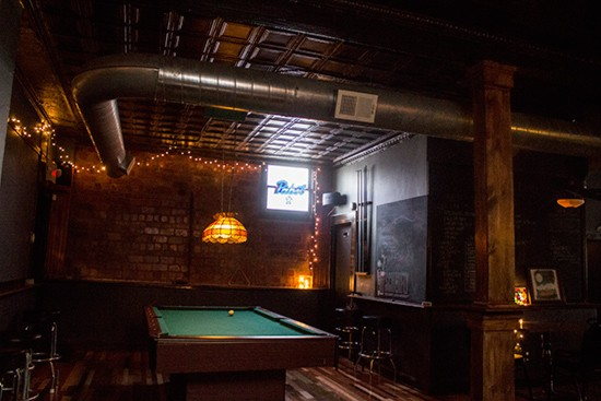 A pool table occupies the far corner.
