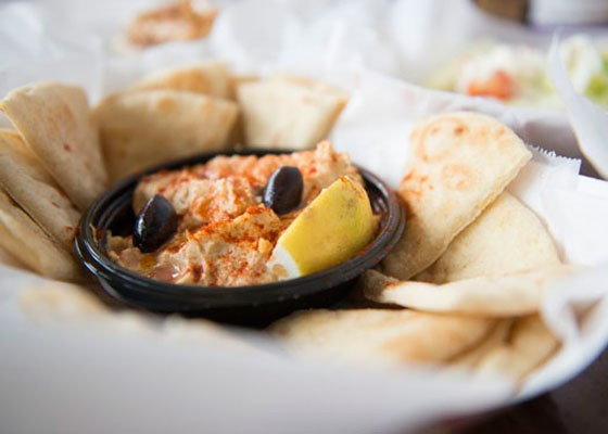 Homemade hummus with toasted pita points. | Corey Woodruff