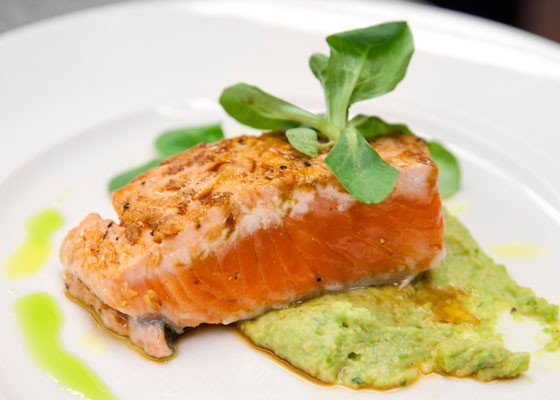 Copper River salmon a la Plancha with a soy-ginger glaze, black carrots and puree of English peas. | St. Louis Magazine
