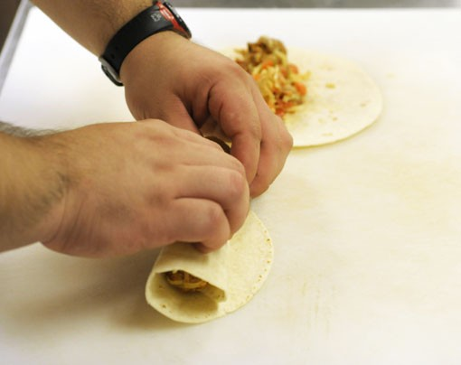 Roll the tortillas. See more photos. - PHOTO: JENNIFER SILVERBERG