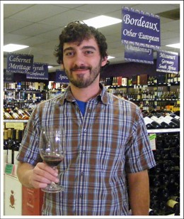 "You know those little thingies wine stores hang from the shelf along with the price card? They're called ""Shelf Talkers."" This guy, Chris Spina of the Wine & Cheese Place, he's more Gut Check's idea of a Shelf Talker. - KATIE MOULTON"