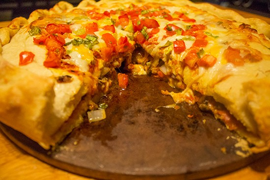 Is it a pizza? Is it a calzone? Either way, it's a whole lotta food. | Mabel Suen