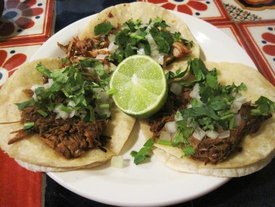 Barbacoa tacos (and a carnitas taco in back) at Tienda El Ranchito - IAN FROEB