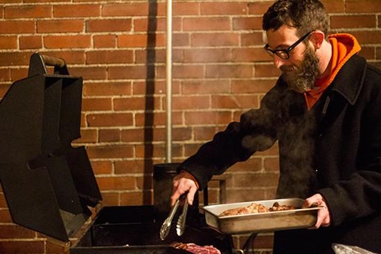 Grilling up pork steaks.