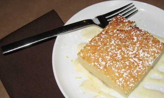 Crustless Buttermilk pie with lemon creme anglaise and lemon zest. - STEPHEN FAIRBANKS