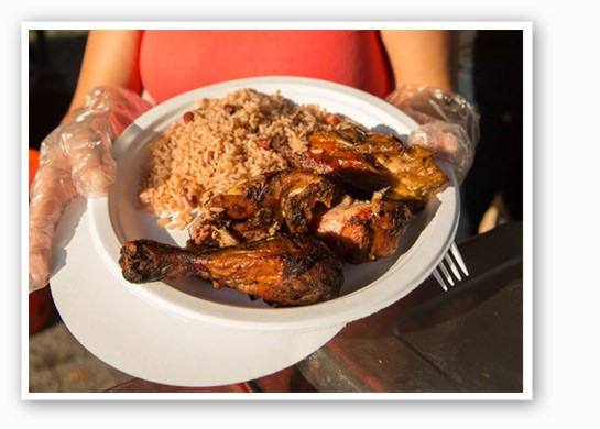 Jerk chicken and beans from the Jamaican tent. | Theo Welling