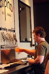 Langeneckert pours a beer for a customer. - CAILLIN MURRAY