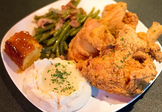 Another look at the four-piece fried chicken dinner with green beans, mashed potatoes with gravy, and maple-glazed cornbread.