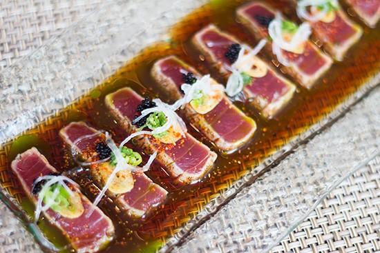 "BaiKu's ""Tuna Tiradito,"" lightly seared big-eye tuna with ponzu, chive oil, tobiki, spooled daikon, schchimi togarashi and toasted garlic chips."
