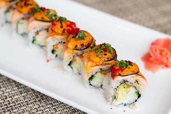"The ""Onisan"" with lemon-garlic crab, cucumber, avocado, gobo, salmon, jalapeno, chili aioli, ponzu tobiko and scallions."