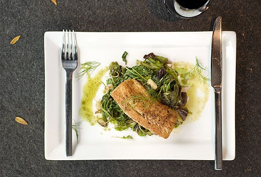 Lake Superior Walleye is served on wilted greens and arugula with fennel olives, cucumbers, tomatoes and extra virgin olive oil with basil. View a Terrace View slideshow. - PHOTO: JENNIFER SILVERBERG