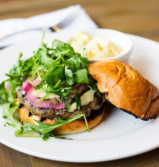 """The """"House Burger,"""" a Rain Crow ground-beef short-rib burger with aged white cheddar and pickled onions. 