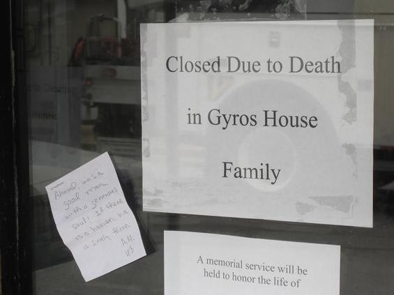 This sign was posted after the recent death of Ahmed Eltawmi, 50, who owned the Gyro House in the Delmar Loop. Eltawmi was shot and killed on June 4, 2010  outside his apartment in Maplewood. Customers, family and friends placed flowers next at the foot of the door outside the business. Read more about this story.