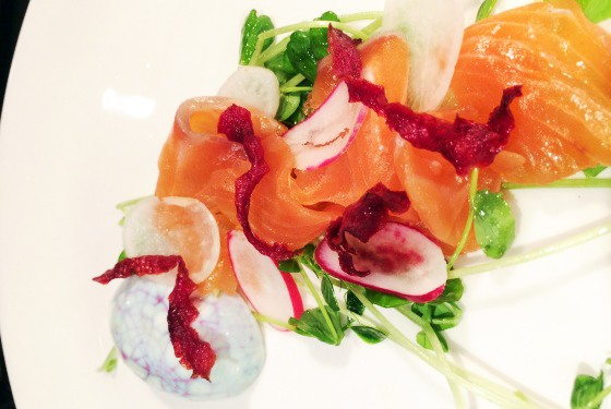 House-cured salmon with pea shoots, red wine-marinated six-minute egg, crème fraiche, beet chips and pink peppercorns. | Brian Hardesty