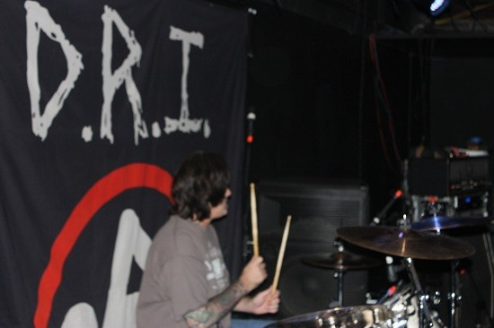 dri_blurry_drummer_with_banner.jpg