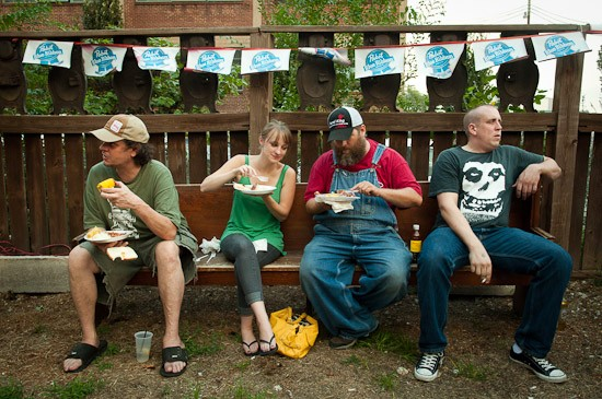 Attendees of the Off Broadway Pig Roast eat their plates of Indonesian-roasted pork and sides. - BRIAN HEFFERNAN