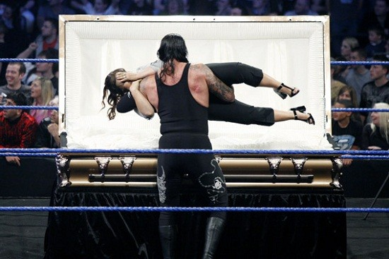 The Undertaker, burying his hairdresser for stealing money. Or maybe not.