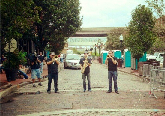 A horn section (the Blue City All-Stars?) plays on Second Street on Saturday afternoon.