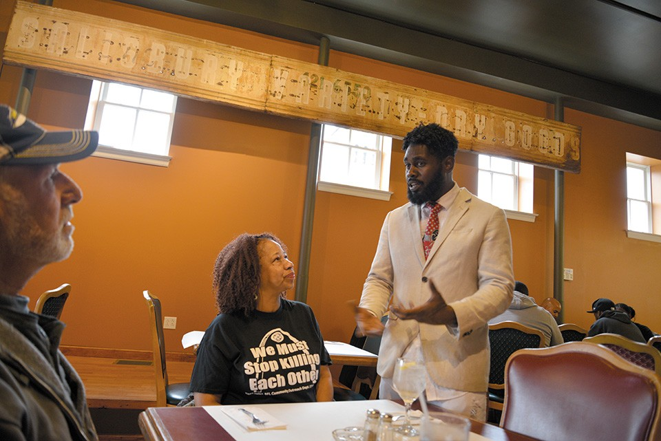 Alderman Brandon Bosley works the room at the River Lillie, one of two newly opened eateries in Hyde Park. City Commissioner of Recreation Evelyn Rice, center, hears him out. - TOM HELLAUER