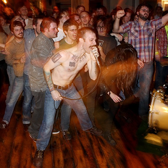 In the past, audience members have typically crowded around bands performing directly on the Tap Room's floor. Here, vocalist Mike Benker performs his final show with the Conformists in 2011. - MABEL SUEN