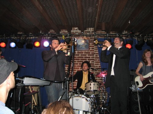 Bob Schneider (left) at the Duck Room, June 9, 2009, with Ollie Steck (trumpet), Conrad Choucroun (drums) and Harmoni Kelley (bass) - KEN STONER