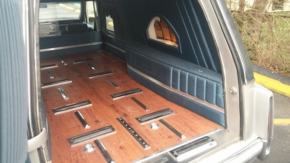 The casket rollers make it easy to move gear into and out of the hearse. - NIKKI STRYCHNINE