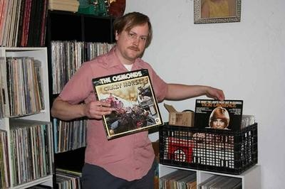 Matt Harnish with a small sample of his expansive record collection - JON SCORFINA