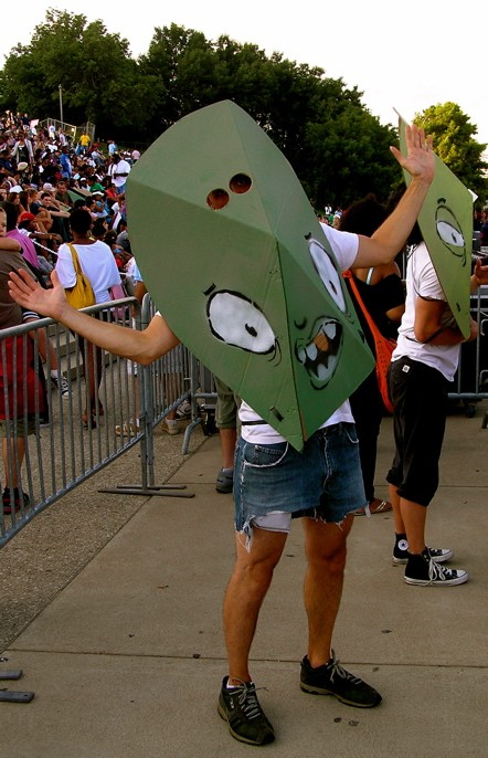 """Green meanie masks were handed out by Black Spade and co., jean shorts were not. (See more photos here: """"Lupe Fiasco under the Arch, 8/1/09"""")"""