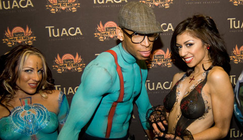 Tuaca Body Art ball brings out the exhibitionists and presumably, people who enjoy free Tuaca. - IMAGE VIA HTTP://WWW.TUACABODYARTBALL.COM/GALLERY.ASPX