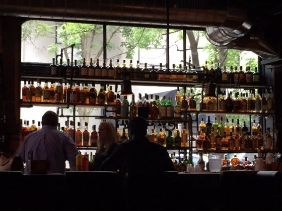 The bar at The BBQ Saloon contains an extensive selection of whiskey, including some real rarities. - PHOTO BY JOHN SCHOEMEHL