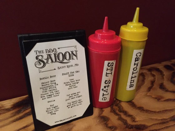The BBQ Saloon features two sauces, STL-style and Carolina. - PHOTO BY SARAH FENSKE