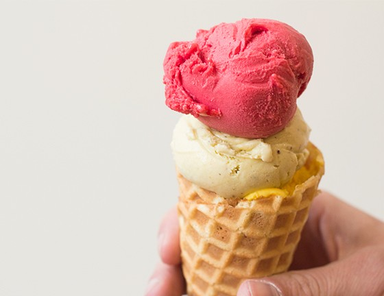 A housemade waffle cone filled with three scoops of Jeni's ice cream: raspberry sorbet, pistachio and honey, and mango lassi. | Photos by Mabel Suen