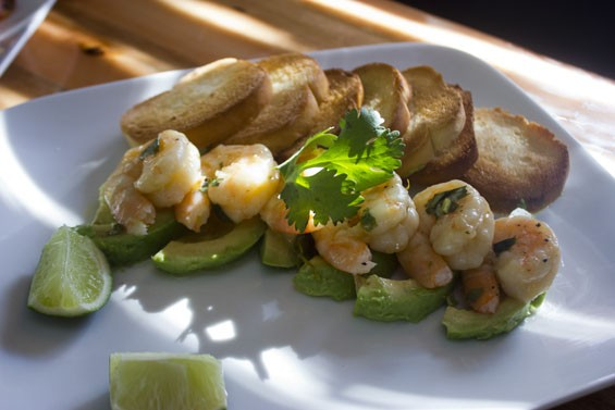 Shrimp and avocado ceviche is tossed in a citrus vinaigrette. For a gluten-free option, get it with lettuce instead of crostini. - PHOTO BY SARAH FENSKE
