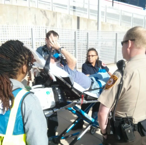 Above, a man suspected of drunkenly causing an altercation on the Blue Line is finally taken away by EMS at the Shrewsbury station. - PHOTO COURTESY OF A METROLINK PASSENGER