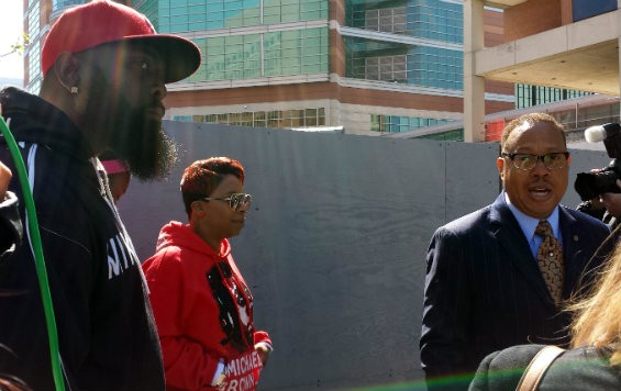 Michael Brown Sr., Lesley McSpadden and attorney Anthony Gray arrive at the St. Louis County Courthouse. - JESSICA LUSSENHOP